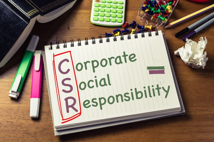 CSR (Corporate Social Responsibility) text on notebook on the desk